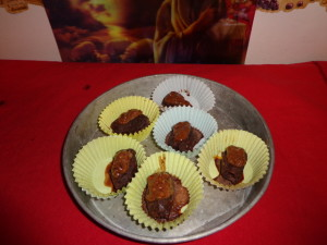 chocolate covered stuffed almond dates drizzled with butter nectar cream sauce