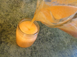 carrot pineapple lime apple juice pouring into glasses