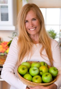 mimi kirk with a bowl of apples