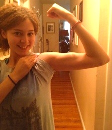 Miliany flexes a bicep after a workout.