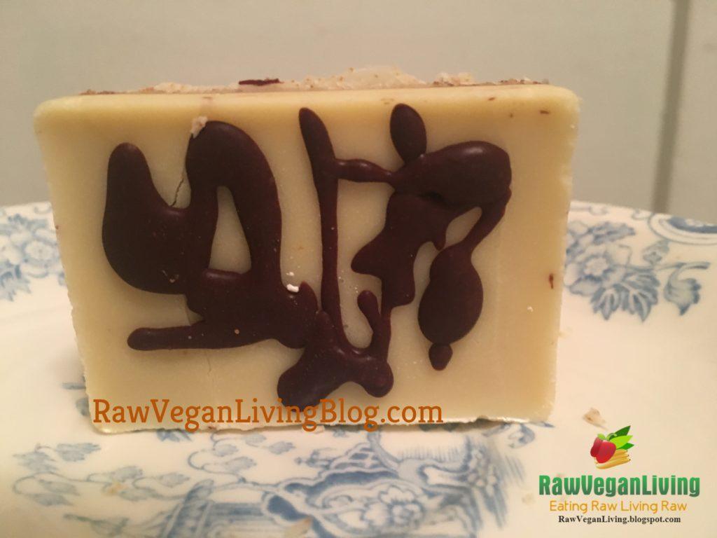 raw vegan white chocolate with chocolate sauce drizzle.