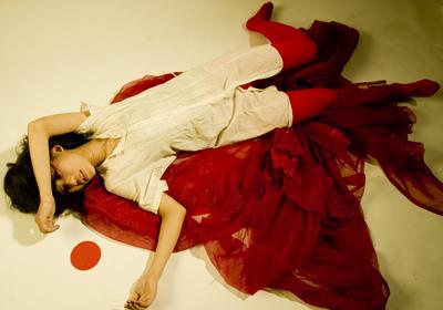 women hemorrhging on floor